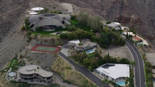 AX0010_137 - 5K stock footage aerial video orbit spacious mansion in the hills in West Palm Springs, California