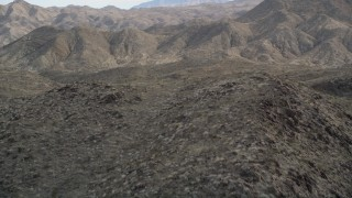 AX0010_138 - 5K stock footage aerial video approach and fly over arid ridge in the San Jacinto Mountains, California