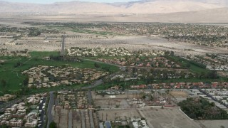 AX0010_139 - 5K stock footage aerial video orbit suburban homes on golf course in South Palm Springs, California