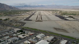 AX0010_144E - 5K stock footage aerial video of approaching the runway at Palm Springs International Airport, California