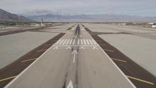 AX0010_145 - 5K stock footage aerial video of descending toward runway at Palm Springs International Airport, California