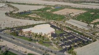 AX0010_147 - 5K stock footage aerial video approach and orbit museum and office building in East Palm Springs, California