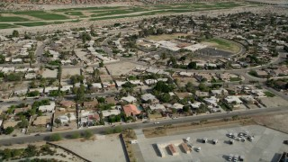 AX0010_149 - 5K stock footage aerial video orbit suburban neighborhoods in Cathedral City, California