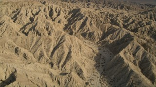 AX0011_004 - 5K stock footage aerial video of flying over mountains in the Mojave Desert, California