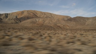 AX0011_013 - 5K stock footage aerial video low altitude flyby of desert mountains in Joshua Tree National Park, California