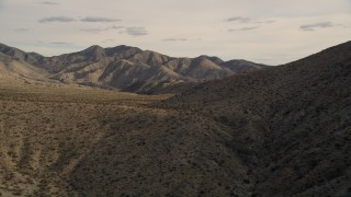 AX0011_020 - 5K stock footage aerial video of flying by desert mountains in Joshua Tree National Park, California