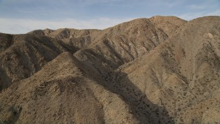 AX0011_021 - 5K stock footage aerial video orbit desert mountain ridges in Joshua Tree National Park, California