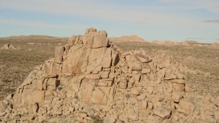 AX0011_031 - 5K stock footage aerial video fly over desert rock formation, Joshua Tree National Park, California