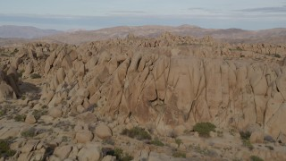 AX0011_039 - 5K stock footage aerial video fly over rock formations, Joshua Tree National Park, California