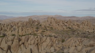 AX0011_040 - 5K stock footage aerial video fly over rock formations, Joshua Tree National Park, California