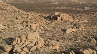 AX0011_042 - 5K stock footage aerial video of flying by rock formations, Joshua Tree National Park, California