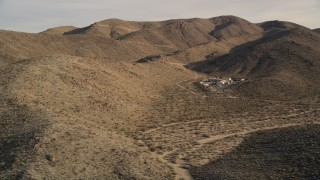 AX0011_046 - 5K stock footage aerial video of isolated buildings in the desert, Joshua Tree National Park, California
