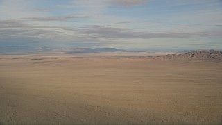 AX0011_067 - 5K stock footage aerial video of a view across the Mojave Desert in California