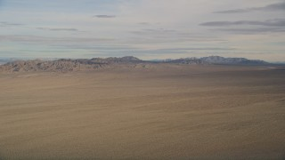 AX0011_068 - 5K stock footage aerial video of a view across the Mojave Desert to mountains in California