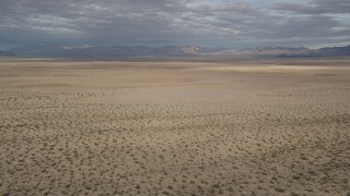 AX0011_072 - 5K stock footage aerial video fly low over open desert, Mojave Desert, California
