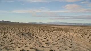 AX0011_073 - 5K stock footage aerial video fly low over desert vegetation while descending, Mojave Desert, California