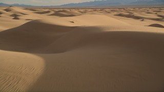 AX0012_008 - 5K stock footage aerial video of flying over sand dunes, Kelso Dunes, Mojave Desert, California