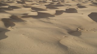 AX0012_023 - 5K stock footage aerial video fly over sand dunes, Kelso Dunes, Mojave Desert, California