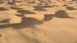 AX0012_023E - 5K stock footage aerial video fly over sand dunes, Kelso Dunes, Mojave Desert, California