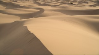 AX0012_027E - 5K stock footage aerial video fly low over sand dunes, Kelso Dunes, Mojave Desert, California