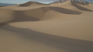 AX0012_035 - 5K stock footage aerial video fly over sand dunes, Kelso Dunes, Mojave Desert, California