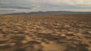 AX0012_038 - 5K stock footage aerial video fly by open desert, Mojave Desert, California
