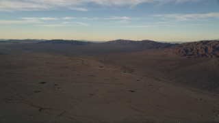 AX0012_056 - 5K stock footage aerial video of desert plain and mountains at sunset, Mojave Desert, California