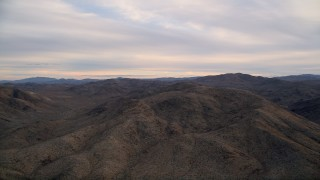 AX0012_057 - 5K stock footage aerial video fly by desert mountains, Little San Bernardino Mountains, Mojave Desert, sunset