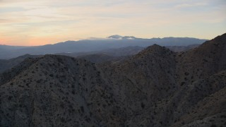 AX0012_062 - 5K stock footage aerial video fly over desert mountains, Mojave Desert, California, sunset