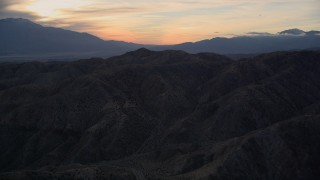 AX0012_064 - 5K stock footage aerial video of the desert mountains, Mojave Desert, California, sunset