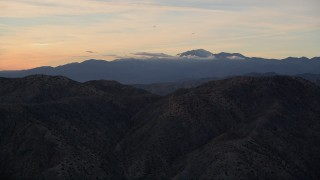 AX0012_065 - 5K stock footage aerial video fly over desert mountains, Mojave Desert, California