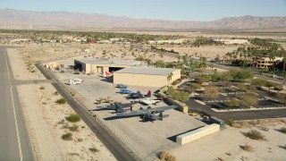 AX0013_001 - 5K stock footage aerial video fly by planes at the air museum, Palm Springs, California