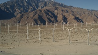 AX0013_005 - 5K stock footage aerial video of wind farm in the desert, San Gorgonio Pass Wind Farm, California