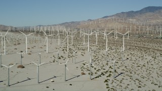 AX0013_006 - 5K stock footage aerial video of wind farm in the desert, San Gorgonio Pass Wind Farm, California