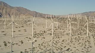 AX0013_006E - 5K stock footage aerial video of wind farm in the desert, San Gorgonio Pass Wind Farm, California