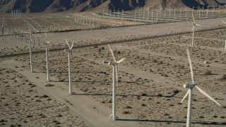 AX0013_010 - 5K stock footage aerial video of desert wind farm, San Gorgonio Pass Wind Farm, California