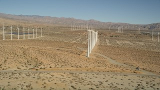 AX0013_013 - 5K stock footage aerial video fly by windmills in the desert, San Gorgonio Pass Wind Farm, California