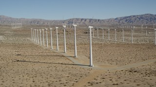 AX0013_014 - 5K stock footage aerial video of flying by windmills in the desert, San Gorgonio Pass Wind Farm, California