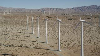 AX0013_015 - 5K stock footage aerial video fly by rows of windmills, San Gorgonio Pass Wind Farm, California