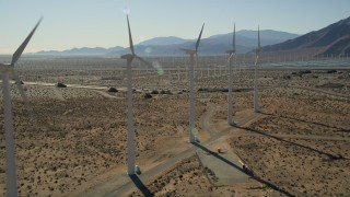 AX0013_017E - 5K stock footage aerial video fly by rows of windmills, San Gorgonio Pass Wind Farm, California