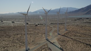 AX0013_018 - 5K stock footage aerial video fly by row of windmills, San Gorgonio Pass Wind Farm, California