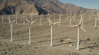 AX0013_020E - 5K stock footage aerial video of flying by rows of windmills, San Gorgonio Pass Wind Farm, California