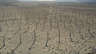 AX0013_028E - 5K stock footage aerial video fly over windmill farm in the desert, San Gorgonio Pass Wind Farm, California