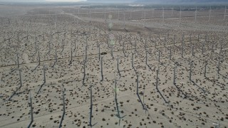 AX0013_029 - 5K stock footage aerial video fly over windmills in the desert, San Gorgonio Pass Wind Farm, California