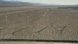 AX0013_031 - 5K stock footage aerial video fly by windmills in the desert, San Gorgonio Pass Wind Farm, California
