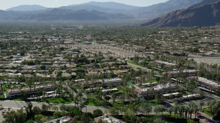 AX0013_033 - 5K stock footage aerial video fly over apartment buildings toward residential road, Palm Springs, California