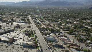 AX0013_034 - 5K stock footage aerial video of following a road through an industrial area, North Palm Springs, California