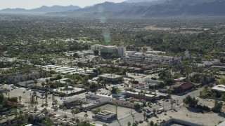 AX0013_035 - 5K stock footage aerial video of approaching a medical center, West Palm Springs, California