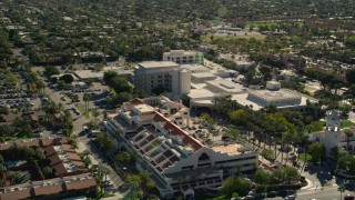 AX0013_035E - 5K stock footage aerial video of approaching and orbiting a medical center, West Palm Springs, California