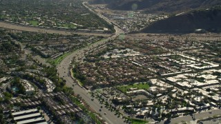 AX0013_042 - 5K stock footage aerial video of a street winding through neighborhoods, South Palm Springs, California